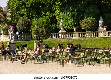 Paris, France - July 07, 2017: Tourists and Parisians relaxing in the Luxembourg Gardens (Jardin du Luxembourg), one of largest public park in Paris, in summer at sunset.