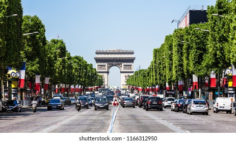 Paris, France - July 07, 2017: The Avenue des Champs Elysees and Arc de Triomphe (Arch of Triumph of the Star) in the summer.