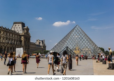 PARIS, FRANCE - JULY 07 2018: Tourists outside of the Lourve museum on July 07,2018 in Paris, France
