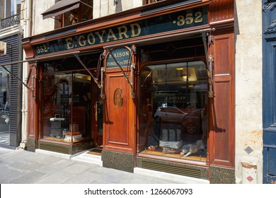 PARIS, FRANCE - JULY 07, 2018: Goyard luxury store in Paris with windows and wooden facade in summer, sunlight
