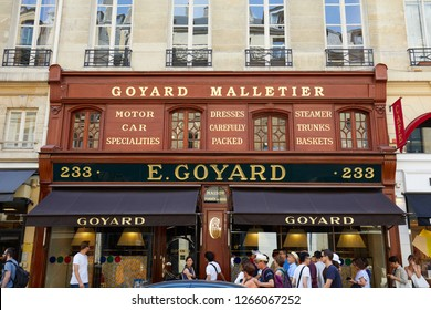 PARIS, FRANCE - JULY 07, 2018: Goyard luxury store in Paris with window and wooden facade in summer, people waiting