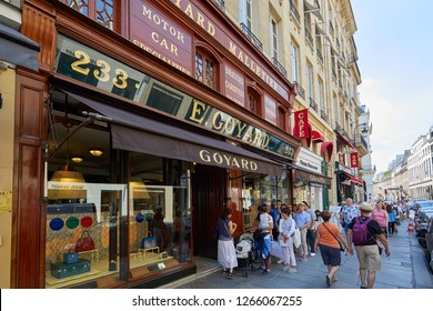 PARIS, FRANCE - JULY 07, 2018: Goyard luxury store in Paris with window and wooden facade and people waiting in queue