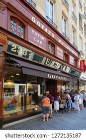 PARIS, FRANCE - JULY 07, 2018: Goyard luxury store in Paris with window and and people waiting in line