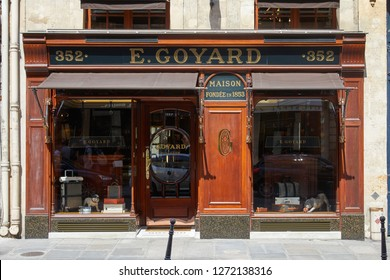 PARIS, FRANCE - JULY 07, 2018: Goyard luxury store in Paris with windows and wooden facade in a sunny summer day