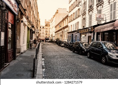 Paris, France - July 07, 2018: People on a picturesque street in Montmartre neighborhood