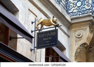 PARIS, FRANCE - JULY 07, 2018: Goyard luxury store in Paris, ancient black sign with golden french bulldog sculpture