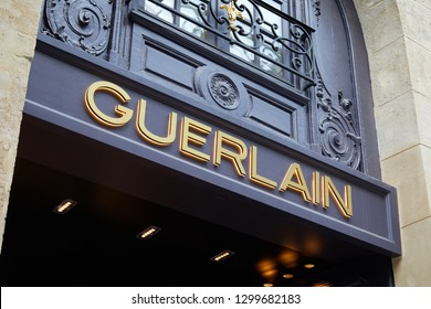 PARIS, FRANCE - JULY 07, 2018: Guerlain store with golden letters sign in Paris and ancient building facade