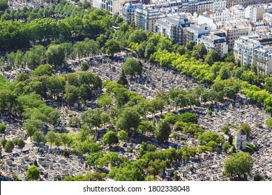 Paris, France - July 09 2020: Areal view of Montparnasse cemetery, famous graveyard in Paris, France. Day shot from Tour Montparnasse observation desk.