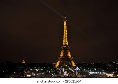 PARIS, FRANCE- JULY 10: The famous Eiffel tower illuminated by night, seen from the distance on July 10, 2011 in Paris, France.