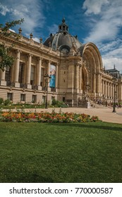 "Paris, France - July 11, 2017. People and garden in front the Petit Palais's facade in Paris. Known as the ""City of Light"", is one of the most impressive world's cultural center. Northern France."