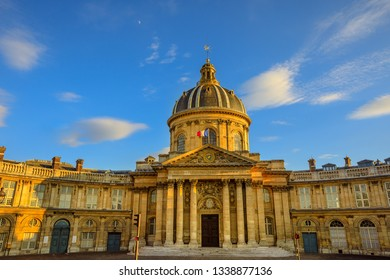 Paris, France -July 1,2017:Central dome of Institut de France building, a French learned society group of five academies in Paris. Institut de France with Bibliotheque Nazarine in a sunny day blue sky