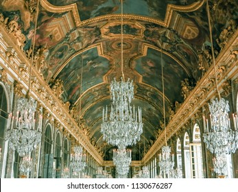 Paris, France. July 12th, 2014. The ceiling of the Hall of Mirrors in Versaille, France, with murals and chandeliers.