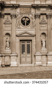 PARIS, FRANCE - JULY 13, 2014: View fragments of Louvre buildings in Louvre Museum. Louvre is one of the largest and most visited museums worldwide. Vintage, sepia.