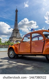 PARIS, FRANCE - JULY 13, 2019: Two Parisian symbols—the Eiffel Tower and Citroen 2CV. High Resolution Image.