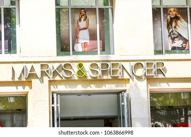 Paris, France - July 14, 2014: Entrance of Marks & Spencer showroom with name on streets of Paris, France. Marks and Spencer is a major British multinational retailer, specialising in clothing.