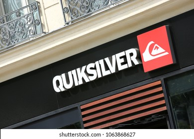 Paris, France - July 14, 2014: Quiksilver text written outside store and red logo over black background in Paris, France. Quiksilver is an American retail sporting company, founded in Australia