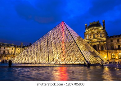 PARIS, FRANCE - JULY 14, 2014: The Louvre at night is one of the world's largest museums  in Paris, July 14, 2014