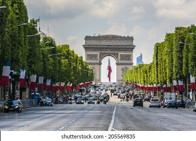 PARIS, FRANCE - JULY 14, 2014: The Champs-Elysees. Champs-Elysees - the most famous avenue of Paris has 1910m and is full of stores, cafes and restaurants.
