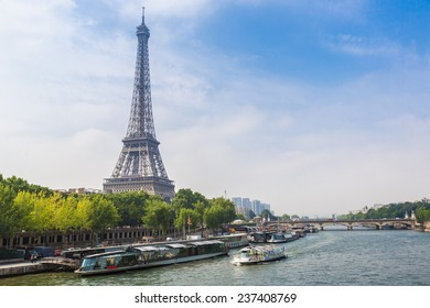 PARIS, FRANCE - JULY 14 2014: Seine in Paris and Eiffel tower in beautiful summer day in Paris, July 14, 2014