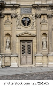 PARIS, FRANCE - JULY 14, 2014: View of Sculptures on the Louvre building in Louvre Museum. Museum is one of the largest and most visited museums worldwide.