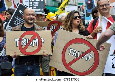 PARIS, FRANCE - JULY 14, 2017 : On the french national day, demonstration against Trump, Macron and french labor law.