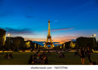 PARIS, FRANCE - JULY 14. 2017: Eiffel Tower at sunset is the most visited monument in France and the most famous symbol of Paris