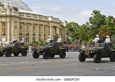 PARIS, FRANCE - JULY 14: Motorized and armored forces at a military parade (Defile) in the Republic Day (Bastille Day) on the Champs Elysees in Paris, France on July 14, 2012