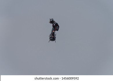 PARIS, FRANCE July 14th 2019 : Franky Zapata flies with his own creation, a jet powered flyboard during the traditional military parade for the bastille day in front of the presidential platform.