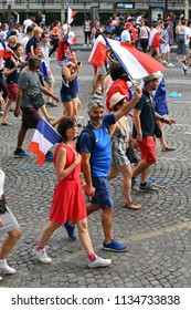 PARIS, France – July 15, 2018 : jubilant french fans on the streets of Paris celebrating France's victory over Croatia in the 2018 FIFA World Cup Final.