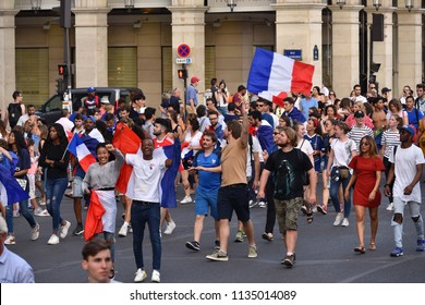 PARIS, France – July 15, 2018 : thousands of jubilant french fans on the Avenue des Champs-Élysées celebrating France's victory over Croatia in the 2018 FIFA World Cup Final.