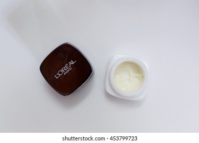 Paris, France, July 17, 2016. An opened jar of L'Oreal skin care cream isolated on a white background