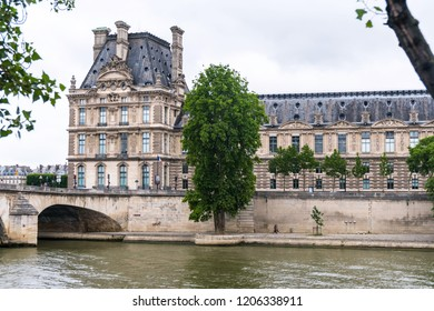 Paris, France - July 19, 2018:  The Louvre Palace Museum from the left bank of the Seine River.