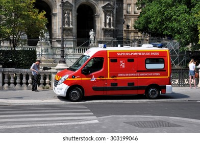 PARIS, FRANCE - JULY 2:  Fire car on the street of Paris downtown on July 2, 2015. The Paris Fire Brigade , is a French Army unit which serves as the fire service for Paris.