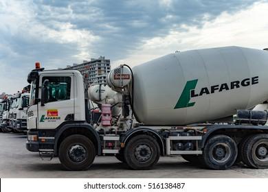 Paris, France - July 20, 2016:  View of Lafarge cement, concrete and aggegates trucks in Paris France.