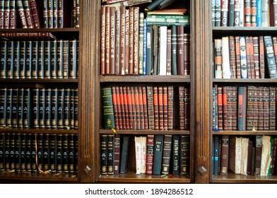 Paris, France - July 2013 A Book Shelf with Jewish books like the Talmud, Mishna, and prayerbooks. Translation: Babylonian Talmud | Psalms
