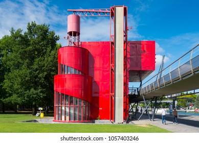 PARIS, FRANCE - JULY 2015 : Parc de la Villette park, park along La Villette River where there are extraordinary red deconstruction architecture spread around the park, City of Science and industry