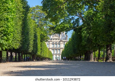 PARIS, FRANCE - JULY, 2016: The Louvre Museum view from Jardin des Tuileries - The Tuileries Garden Park outside the Louvre Museum in Paris, France.