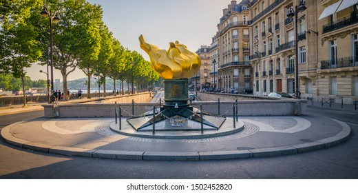 Paris, France - July 2019 : Flame of Liberty, place of Princess Diana death and memorial, replica of the torch of the Statue of Liberty on the Pont de l'Alma bridge in the streets of Paris France