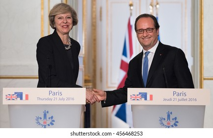 Paris, FRANCE - JULY 21, 2016 : French President Francois Hollande shaking hand to the Prime Minister of United Kingdom Theresa May after a press conference at the Elysee Palace.