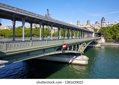 PARIS, FRANCE - JULY 21, 2017: Famous Bir Hakeim bridge with people and tourists in a sunny summer day in Paris, France.