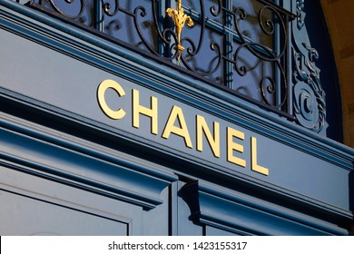 PARIS, FRANCE - JULY 21, 2017: Chanel luxury store sign on blue door in place Vendome in Paris, France.