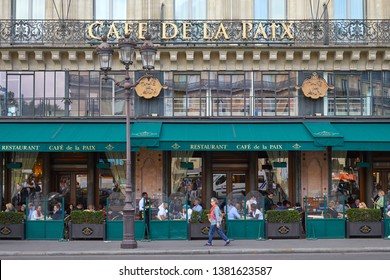 PARIS, FRANCE - JULY 22, 2017: Famous Cafe de la Paix with people and tourists sitting outdoor in Paris, France
