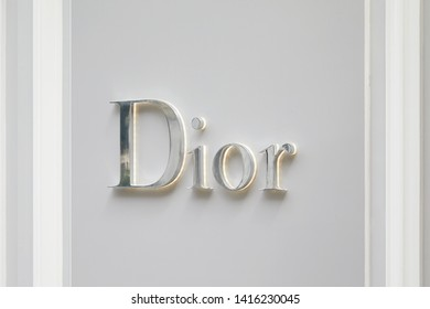 PARIS, FRANCE - JULY 22, 2017: Dior fashion luxury store silver sign in avenue Montaigne in Paris, France.