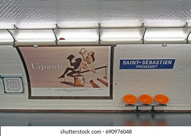 PARIS , FRANCE - JULY 23 ,2017: Paris metro station with orange benches and old white tiles on the wall. july 23 ,2017 in Paris,France