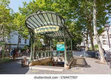 Paris, France - July 23, 2019: Metro Paris Metropolitain entrance Station Abbesses Art Nouveau MRT in France.