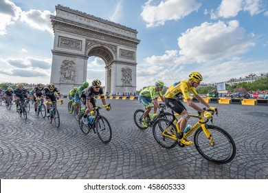 PARIS, FRANCE - JULY 24, 2016 : The road racing cyclist Christopher Froome, wearing the leader's yellow jersey in front of Arc de Triomphe during the Tour de France 2016 on the Champs Elysees Avenue.