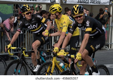 PARIS, FRANCE - JULY 24, 2016 : The British professional road racing cyclist Christopher Froome wearing the leader's yellow jersey rides congratulated by Geraint Thomas during Tour de France 2016.