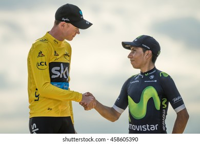 PARIS, FRANCE - JULY 24, 2016 : The road racing cyclist Christopher Froome winner of Tour de France 2016, wearing the leader's yellow jersey shaking hand to Nairo Quintana.