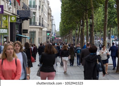 Paris, France - July 24, 2017: People walking on the famous Avenue de Champs-Elysees
