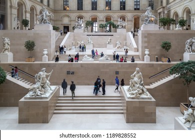Paris, France - July 24, 2017: Hall with sculptures and stairs in the famous Louvre Museum